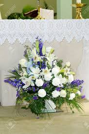 Purple And White Flowers Decorate Church On Wedding Day Stock Photo