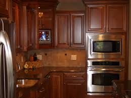 Diamond Prelude Cabinet Catalog by Decorating Brown Wooden Kraftmaid Cabinets With Black Countertop