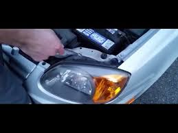 how to replace a headlight on a hyundai accent 2005
