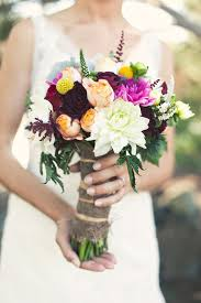 A Burlap Textured Fabric Wrapped Around This Gorgeous Hand Tied Bouquet Adds Rustic