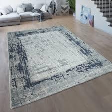 wohnzimmer teppich bordüre meliert blau grau