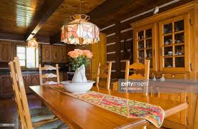 Pinewood Chairs Table And Furnishings In The Dining Room Of A Canadiana Cottage Style Residential Log Home Quebec Canada This Image Has Limited Use P