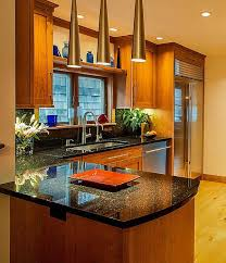 Stain Grade Oak Cabinets With Black Galaxy Granite Counters
