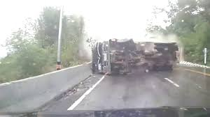 100 Truck Slides On Sharp Curve Hitting Motorcyclist