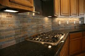 backsplash ideas wooden cabinet brown counter light