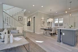 Transitional Living Room With Vinyl Plank Flooring Linkwerks Neutral Colors Light Grey Sofa