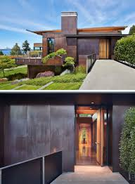 100 Cedar Siding DarkStained And Copper Panels Cover The Exterior Of