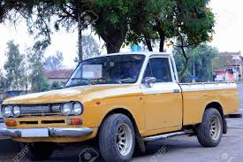 Old Japanese Pickup Truck Painted Dark Yellow And White With.. Stock ...