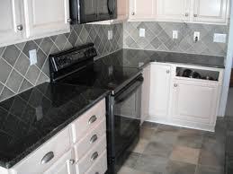 kitchen granite countertops omaha in black with tile flooring