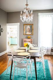 Gorgeous Dining Room With A Turquoise Rug