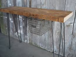 Rustic Industrial Console Table Made From Reclaimed Wood With Metal Legs And Mounted Wire Basket Storage Ideas