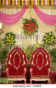 Decoration Using Flowers Cloth And Bamboo For Wedding Reception In Indian Hindu Maharashtrian Ceremony