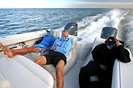 Anglers Sitting In Bean Bag Chairs On A Center Console Fishing Boat