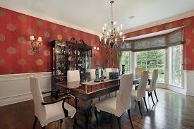 Formal Dining Room With Red Wallpaper White Chairs Dark Wood Table And