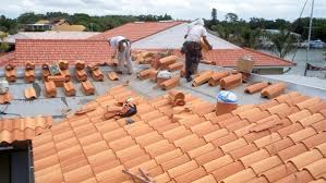 roofers installing tile shingle roof on florida home marvelous