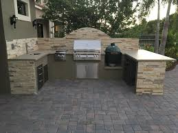 Custom Outdoor Kitchen With Alfresco ALXE Grill Double Side Burner Big Green Egg And Dekton Countertop