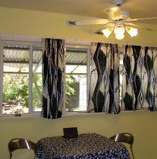 Ideas For Kitchen Curtains Small Dining Table Set Black Ceramic Countertops Bridge Faucet White