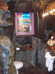 caveman room bathroom with urinal waterfall in right hand corner