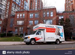 UHaul Moving Truck Parked In Front Of Apartment Building Stock Photo ... Renting A Uhaul Truck Cost Best Resource 13 Solid Ways To Save Money On Moving Costs Nation Low Rentals Image Kusaboshicom Rental Austin Mn Budget Tx Van Texas Airport Montours U Haul Review Video How To 14 Box Ford Pod When Looking For A Moving Truck Youll Likely Find Number Of College Uhaul Trailers Students Youtube Self Move Using Equipment Information 26ft Prices 2018 Total Weight You Can In Insider