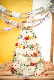 Multi Tiered Wedding Cake With Red And Yellow Wildflowers