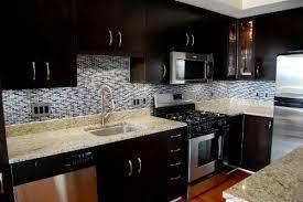 modern style dark kitchen cabinets white subway tile backsplash