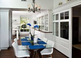 Los Angeles Glass Pocket Door Dining Room Traditional With White