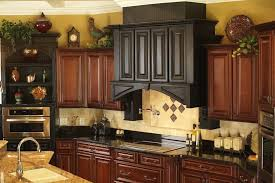 what to put above kitchen cabinets granite countertop brown wood
