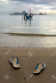 Slippers Of The Fisherman Thai Fishermen Off His On Beach Walk Barefooted To