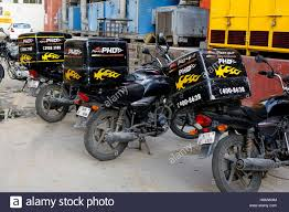 Pizza Hut Delivery Bikes Standing In Row