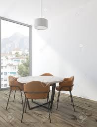 minimalistische weiße esszimmer ecke mit einem runden weißen tisch und braunen braunen stühlen spott der wiedergabe 3d