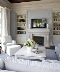Cozy Shabby Chic Fireplace Mantel With Built In Bookcase And Gray Sectional Sofa Plus White Coffee Table Lounge Chairs Also Area Rug Patterned