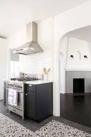 black shaker kitchen cabinets with white beveled backsplash tiles