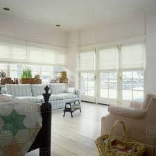 Light And Airy Bedroom View Towards Windows With White Fabric