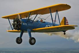 Wally Falardeau Tucks His Boeing PT 17 Stearman In Close To The Camera Over Northern Illinois On A Cloudy Summer Day July 2005 Photo By Buck Wyndham