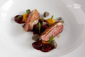 cuisine pigeon pigeon breast with sour cherry sauce poppy seed crumbs and
