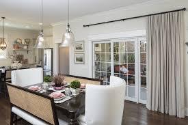 Interior Dining Room With Sliding Glass Door Having Cream Curtain Hanging On Black Iron Rods