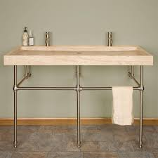 Trough Sink Vanity With Two Faucets by White Sink And Steel Faucet Above Grey Wooden Vanity On Laminate