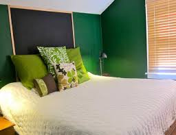 Unusual Green Cushions On White Cover Master Bed Set Added Wall Painted And Table Lamps