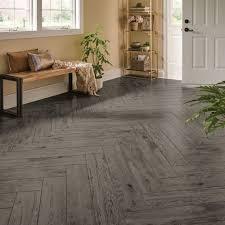 Luxury Vinyl Plank Imitating Gray Hardwood Flooring Installed In A Herringbone Pattern Country