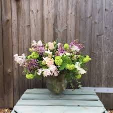 A Rustic Relaxed Vintage Style Vase Table Centre Arrangement Of Spring Flowers
