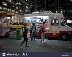 An Ice Cream Truck Does Business Late At Night In New York City ... Tesla To Enter The Semi Truck Business Starting With Semi Logistic Boomlifting On Heavy Truck Stock Photo Image Of Logistic Next Order Please How Get Your Food Business Noticed Crashes Into Telegraph Road Nation And World News Lessons Can Learn From Sitdown Restaurants Efficient Drivetrains Inc Edi Continues Ev Leadership In Medium Uberlike Underway New York Duty Work Completes Zeroemissions Freightliner Vehicle Wraps Grow Starting A Us Bank Academy A Sample Mobile Plan Template Profitableventure