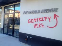 graffiti bombers hit new bed stuy building with gentrify here tag