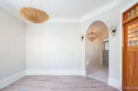 living room light gray grey walls white trim gold chandelier