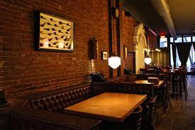 restaurant le bureau enjoy delicious flambéed tapas at bureau bar in griffintown prével