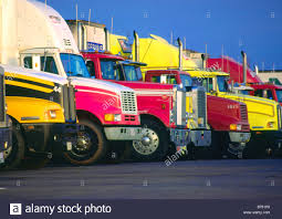 A Row Of Tractor Trailer Trucks Stock Photo: 21646074 - Alamy Tctortrailer Truck On A Us Inrstate Highway Stock Photo Truck Trailer Transport Express Freight Logistic Diesel Mack Challenges American Simulator Tamiya America Inc Fuel Tank Trailer 114 Semi Horizon Hobby Tractor Wash Detailing Custom Chrome Texarkana Ar Unit Wikipedia Nozone Areas Indianapolis Circa September 2017 Colorful Cars Truck Tractor Trailer Red Pixar Android Wallpapers Amazoncom Log Diecast Replica 132 Scale Assorted