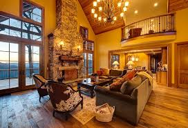 Rustic Living Room With Cathedral Ceiling Chandelier Transom Window Loft Stone Fireplace