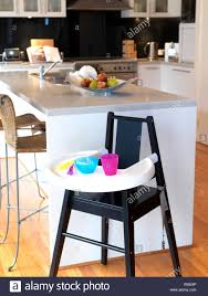 An Infants Highchair In A Modern Kitchen Stock Photo ... Barstoolri Bar Stool With Backrest Solid Wood Frame Ftstool Ding Chair High Stools Yellow Pp Seat Kitchen Folding Step Simple Special Home Goods Square Base Blackpaddedfdinghighchairbreakfastkitchenbarstool Counter Swivel Backless Round Tables 2x Wooden Cafe Padded Gas Lift Black Baby Stepup Helper Espresso Washing Room Buy For Kids Hairkitchen Chairwooden Product H4home Rustic 2 Pcs Acacia Chairs H4home Fnitures Design Redation And Lifting Height Fashion Metal Front Evolu High Chair Pu Leather Gaslift