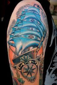 Ocean Blue Ship And Compass Tattoos On Half Sleeve Photo