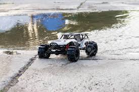 100 Truck Jumps Radio Controlled Monster Performing A Trick At High Speed