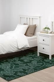 hildigard teppich florales muster grün schwarzer teppich